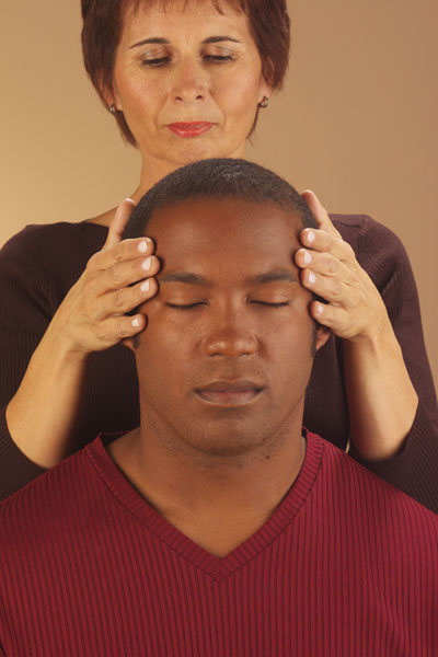 Chairmassage hands on forehead